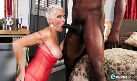 Aged blonde loves her black friend
